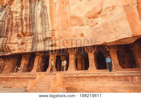 BADAMI, INDIA - FEB 10, 2017: Indian people watching interior of the ancient cave with the 6th century Hindu temple on February 10, 2017. Population of Karnataka state is 62.000.000 people