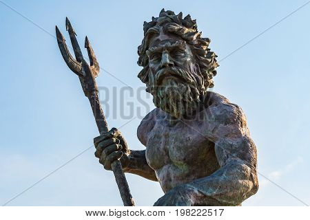 VIRGINIA BEACH, VIRGINIA - JULY 13, 2017:  The King Neptune statue, by sculptor Paul DiPasquale, standing 34 feet tall and located on the oceanfront boardwalk.