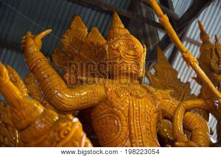 Candle wax shaped as ancient animal on the candle float for candle festival competition in Ubon Ratchathani, Thailand on June 08, 2017.