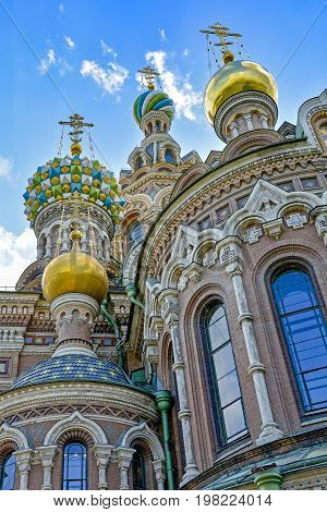 Low view of Savior on the Spilled Blood cathedral with its golden domes and characteristic architecture in St. Petersburg Russia