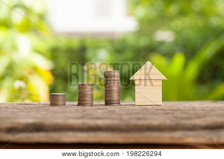 Saving money concept growing business The concept of financial savings to buy a house.
