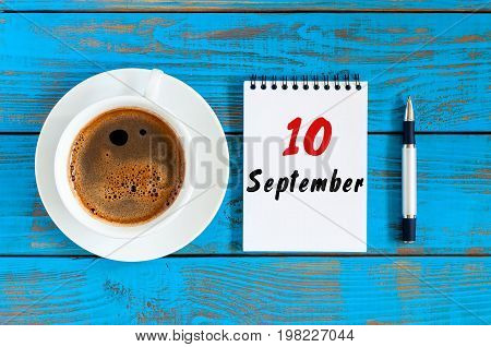September 10th. Day 10 of month, loose-leaf calendar and latte cup at doctor workplace background. Autumn time. Empty space for text.