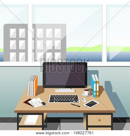 Organization of the workplace in an office at a computer desk. Office workplace at daytime.
