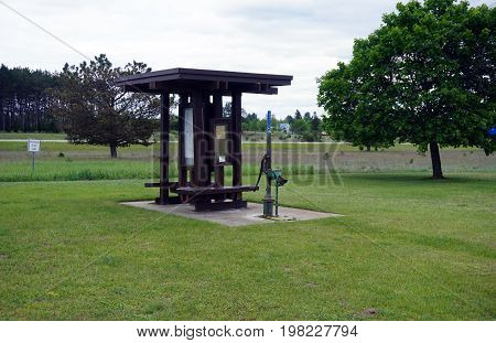 TUSTIN, MICHIGAN / UNITED STATES - MAY 31, 2017: The Tustin Rest Area and Scenic Overlook, on U.S. Highway 131, offers a pump where motorist may obtain potable well water.