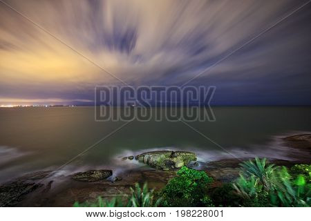 Long Exposure Photography Of The Ocean In The Evening. Romantic Atmosphere Of Peaceful Night At Sea.