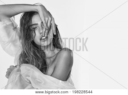 model girl with long wet hair in fashionable white transparent raincoat black and white copy space