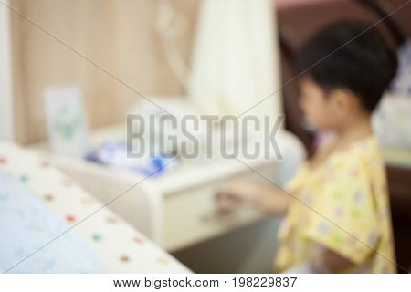 Sick boy in hospital Concept : Boys play because of boredom to the hospital for a long time