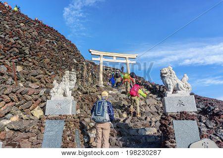 MOUNT FUJI YAMANASHI JAPAN - July 25 2017 : Torii on top of Fuji mountain . Fuji is highest mountain in Japan at 3776 m symbol of Japan
