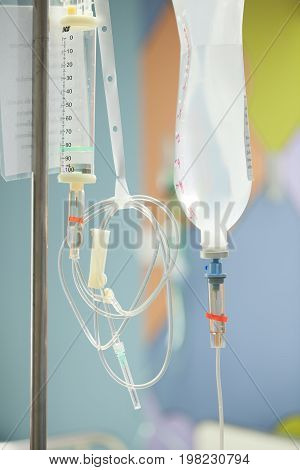 Close up saline IV drip for patient and Infusion pump in hospital.