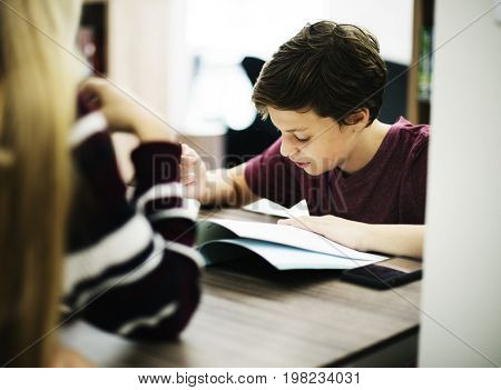 Young boy working on homework assignment