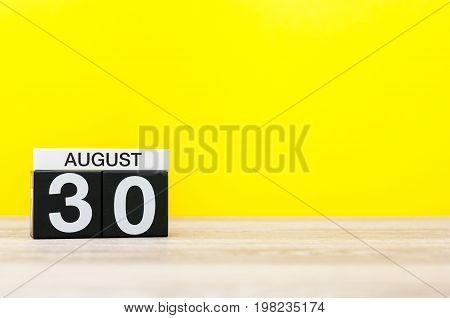August 30th. Image of august 30, calendar on yellow background with empty space for text. Summer time.