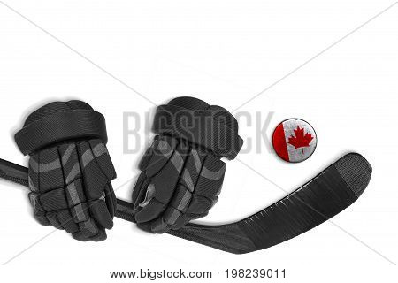 Canadian hockey puck stick and gloves on a white background. Concept hockey