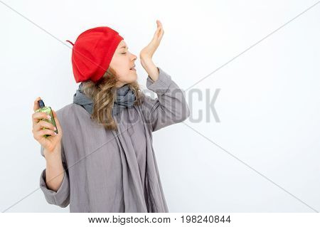 Inspirited French female perfumer creating new scent and testing it. Concentrated young woman with closed eyes trying to guess fragrance. Womens stuff concept