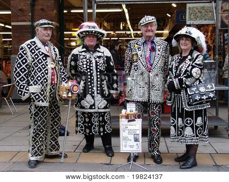 Elderly London Pearlies in full costume at Covent Garden in London