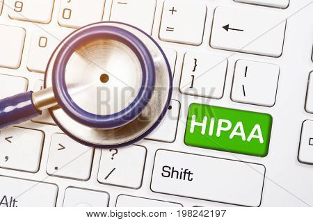 Health Insurance Portability and Accountability Concept - Stethoscope with written HIPPA on coumputer keyboard.