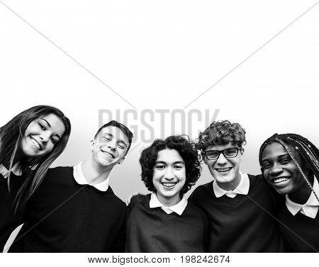 Group of students hugging together