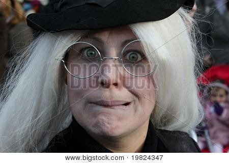 ROCHESTER CITY, KENT ,ENGLAND - DEC 11: Woman in black costume performs at annual Dickens festival in Rochester, Kent, December 11, 2010. The Dickens festival is a literary event in Rochester.