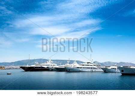 Luxury motorboats and yachts at the dock. Marina Zeas Piraeus Greece