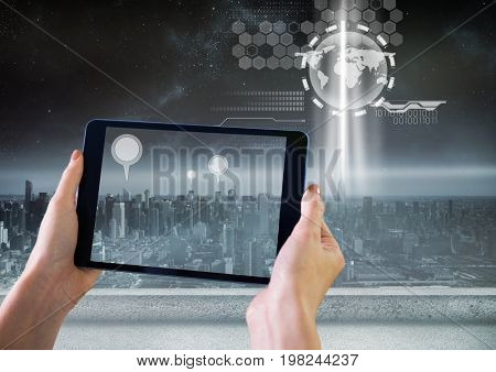 Digital composite of Holding tablet and City with marker location pointers and interface technology