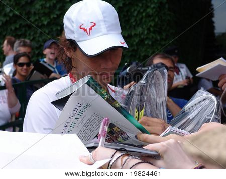 WIMBLEDON, ENGLAND, JUNE 24: Rapha Nadal signing autographs for fans at the Wimbledon Lawn Tennis Championship in Wimbledon, England on June 24, 2010. Rapha Nadal went on to win the championship