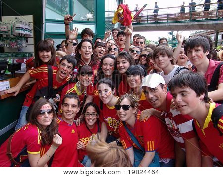 WIMBLEDON, ENGLAND - JUNE 24: Group of lively young Spanish fans at Wimbledon Lawn Tennis Championship in Wimbledon, England on June 24, 2010. Wimbledon is the world's top tennis tournament.