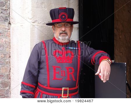 TOWER OF LONDON, LONDON, UK - AUGUST 24: Yeoman of the guard on duty at the Tower of London, UK on the August 24, 2010. The Yeoman of the Guard, also called Beefeaters, protect the crown jewels.