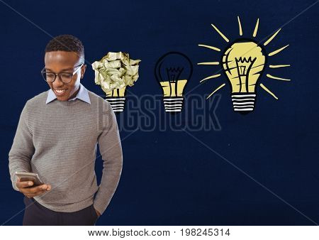Digital composite of Man on phone standing next to light bulbs with crumpled paper ball in front of blackboard