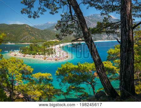 Oludeniz beach full of relaxing people and the Blue Lagoon, Fethiye, Turkey