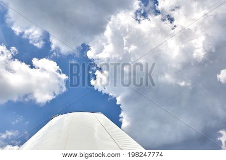 Wing of an airplane on a blue sky Concept of a journey on an airplane.