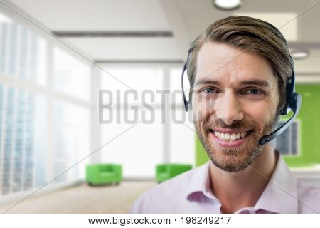 Digital composite of Happy customer care representative man against office background