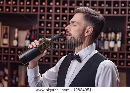 Waiter Drinking Wine