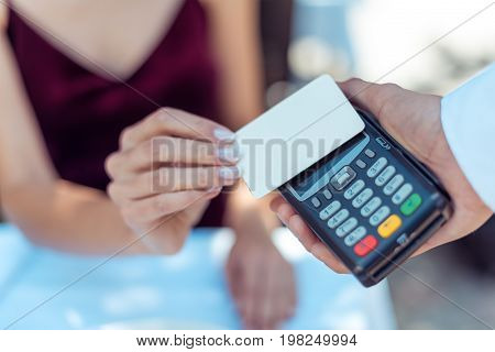 Woman Using Contactless Credit Card
