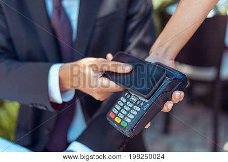 Man Paying With Nfc Technology