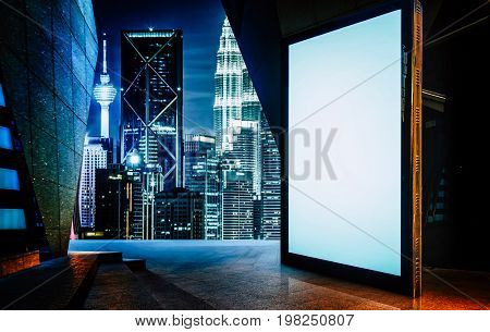 Big empty screen billboard with modern city background .
