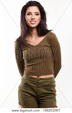 Attractive young brunette woman model wearing stylish army green one shoulder design t-shirt