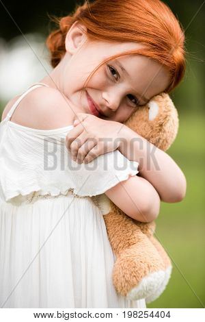 Redhead Girl With Teddy Bear