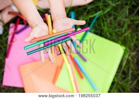 Girl Holding Felt Tip Pens