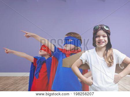 Digital composite of Kids in costumes in blank room