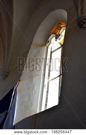 Window inside the fortified medieval church in Dirjiu, Transylvania