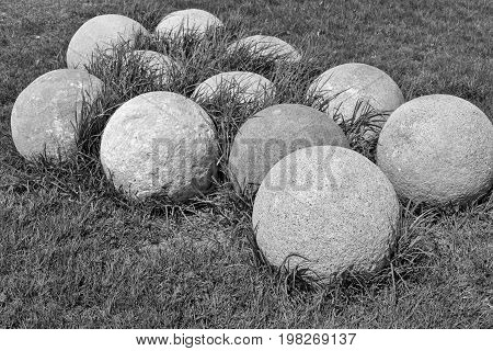 old stone kernels for ancient artillery weapon and for gun of monochrome tone