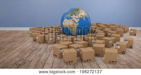 3D image of globe amidst cardboard boxes against room with wooden floor