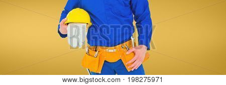 Digital composite of Plumber man holding globes and a helmet against yellow background