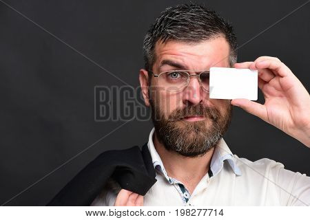 Man With Beard Holds White Card. Businessman With Surprised Face