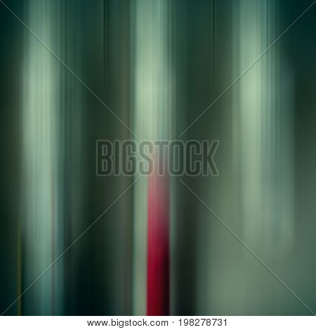 Abstract colored vertical lines blurred background green
