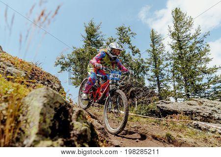Magnitogorsk Russia - July 21 2017: woman rider downhill mountain biking during National championship downhill
