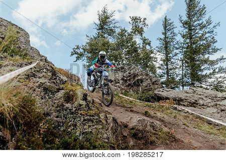 Magnitogorsk Russia - July 21 2017: girl athlete downhill mountain biking during National championship downhill