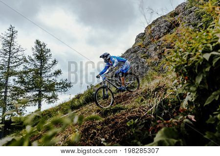 Magnitogorsk Russia - July 21 2017: rider on bike downhill mountain and forest track during National championship downhill