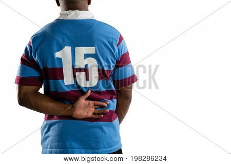 Mid section of male rugby player standing against white background
