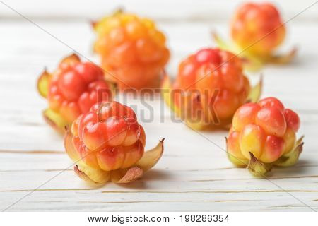 Fresh Organic Berry Cloudberries On Light Wooden Background. Selective Focus