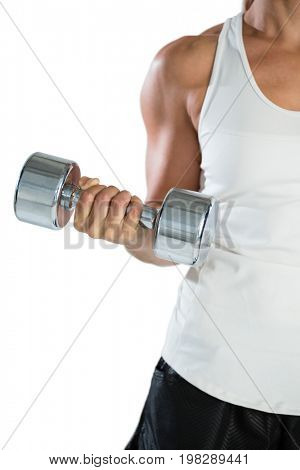Cropped image of female rugby player lifting dumbbell while exercising against white background